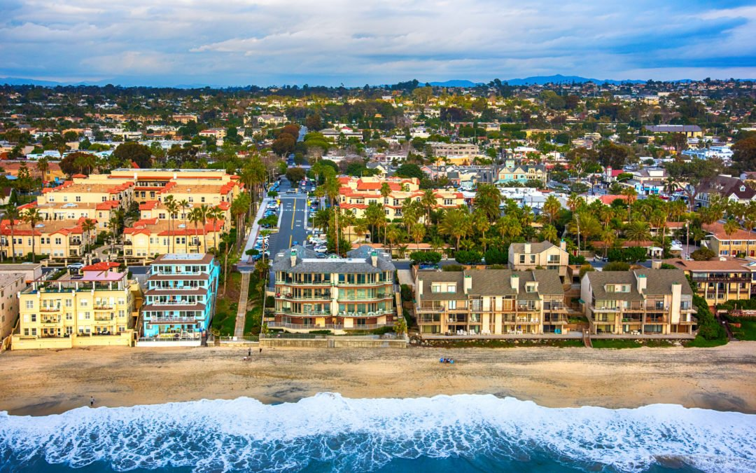 Aerial view of condos lining the beach in the northern San Diego community of Carlsbad, California.